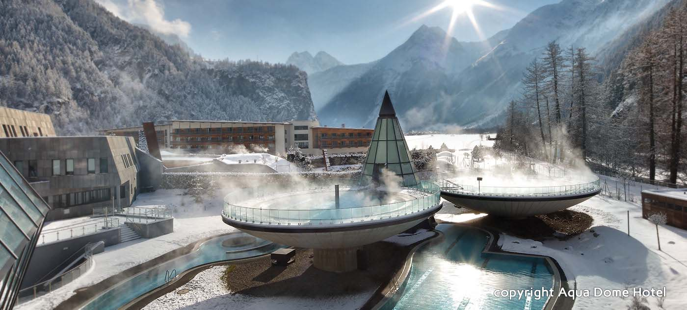 An outdoor thermal spa and resort surrounded by majestic mountains the aqua dome in austria is one very cool hotel imagine basking in the middle of a